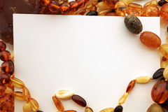 Amber Jewelry avec la carte vierge de note Photographie stock