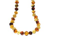 Amber Jewelry Necklace. Amber Necklace with backlighting isolated on white Stock Image