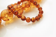 Amber Jewelry. Amber Necklace and bracelet Studio shot on white acrylic with soft reflection Royalty Free Stock Photos