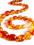 Amber necklace. Closeup of an amber necklace on white background Stock Photo
