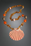 Amber necklace. With shell pendant on neutral background Stock Photos