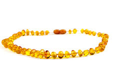Amber necklace. Closeup of an amber necklace on white background Stock Images
