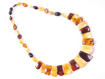 Amber necklace. Beautiful necklace of amber in a white background Stock Photography