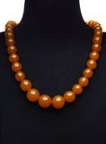 Amber necklace on black mannequin Royalty Free Stock Images