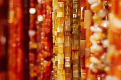 Amber necklace. An amber necklace hanging with other necklaces Royalty Free Stock Photography