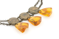 Amber necklace, isolated on white. Vintage accessory made of natural Baltic amber Stock Images