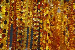 Amber Necklaces. Various amber necklaces are sold in the street market Royalty Free Stock Photography