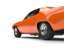 Amber orange vintage race car - rear wheel closeup shot. Isolated on white background Royalty Free Stock Photo