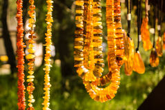 Amber pendants and necklaces at the street market of Curonian Spit, Kaliningrad region. Russia Stock Photos
