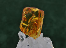 Amber on rock crystal Royalty Free Stock Photo
