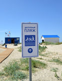 AMBER, RUSSIA. The index  'Available beach' against the background of life-saving station. Stock Photo