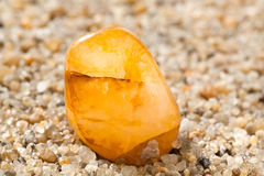 Amber on sand Royalty Free Stock Images