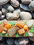 Amber, sea lass and stones. Natural amber, sea glass and stones on Baltic sea coast, Lithuania Stock Photo