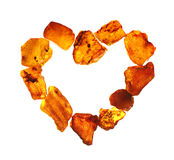 Amber in the shape of a heart Stock Images