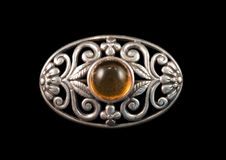 Amber and silver brooch Royalty Free Stock Images