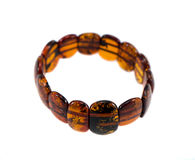 Amber stone bracelet isolated on white Stock Photos