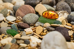 Amber stone. Mineral amber. Rosin yellow amber. Sunstone on a be Stock Images