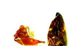 Amber stones on a turn table stock footage