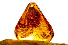 Amber in sun on a beach of the Baltic sea. Amber with inclusions in sun on a beach of the Baltic sea Stock Photography
