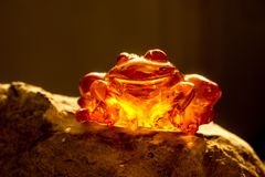 Amber in sun with inclusions. And blurred background stock images