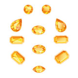 Amber Topaz Set Isolated Objects. Amber and topaz different cut. Bright sunny gems on a white background. Isolated Objects Royalty Free Stock Image
