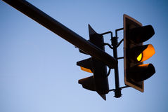 Amber Traffic Light. A amber overhead traffic light with blue sky Royalty Free Stock Image