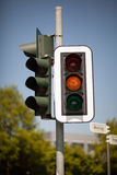 Amber traffic light Stock Images