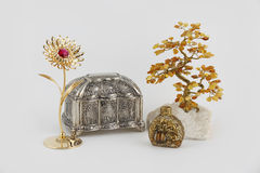 Amber tree and casette, Perfume and gold flower. Gold flower and amber bonsai, bottle of perfume and casette Stock Images