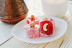 Amber Turkish delight with nuts closeup pots in the background Royalty Free Stock Images
