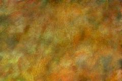 Amber Watercolor Texture / Fine Art Background. 6000 x 4000 @ 300 dpi jpeg file Beautiful shades amber and gold marbled with a green and a sprinkle of brown and Stock Image