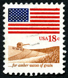 For Amber Waves of Grain US Postage Stamp. UNITED STATES OF AMERICA - CIRCA 1981: A used postage stamp from the USA, showing an agricultural scene and a phrase Stock Images