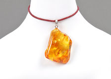 Amber on white bust. Colorful and crisp image of amber on white bust Royalty Free Stock Image