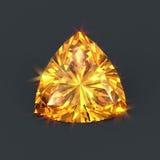Amber yellow diamond Radiant Trillion cut. Isolated precious yellow amber crystal. Trillion cutting with sparkling dazzling glare. Bright shining stone Stock Photo