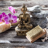 Ambiance for peeling and soothing treatment with Buddha in mind. Spa beauty treatment concept - symbol of detox and cleansing for inner beauty with Buddha on old Royalty Free Stock Photography