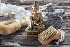 Ambiance for soothing and cleansing treatment with Buddha in mind. Spa beauty treatment concept - symbol of cleansing and peeling for inner beauty with Buddha on Stock Photo