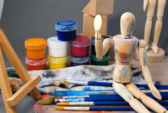 Ambience of art workplace. Classic wooden dummy and other art tools Stock Photography