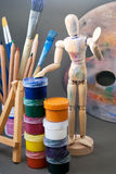 Ambience of art workplace. Classic wooden dummy and other art tools Stock Images
