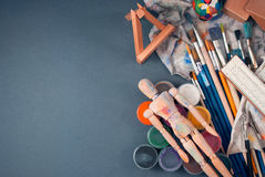 Ambience of art workplace. Classic wooden dummy and other art tools Royalty Free Stock Photo