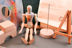 Ambience of art workplace. Classic wooden dummy and other art tools Royalty Free Stock Photography