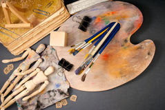 Ambience of art workplace. Classic wooden dummys and other art tools Royalty Free Stock Photos