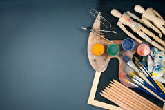 Ambience of art workplace. Classic wooden dummys and other art tools Stock Photo