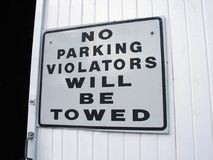 Ambiguous sign. Ironic sign - why won't they be towed Royalty Free Stock Photography