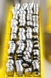 Ambiti di provenienza inossidabili dei cucchiai della sfuocatura Immagini Stock