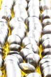 Ambiti di provenienza inossidabili dei cucchiai della sfuocatura Immagine Stock