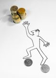 AMBITION. Represented by a human sketch trying to take money, supporte on two coins Royalty Free Stock Photography