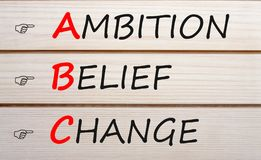 Ambition Belief Change Аcronym Concept. AMBITION BELIEF CHANGE words with ABC written on wood wall decor. Аcronym business concept Stock Photography