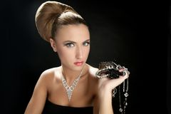 Ambition and greed in fashion woman with jewelry. In hands on black background royalty free stock images