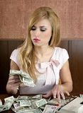 Ambition retro woman lots of dollar money notes. Vintage office stock photos