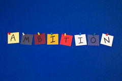 AMBITION - sign for business targets, challenges,. AMBITION - poster or sign of cards with letters and pins on notice board, for business, education, employment stock images