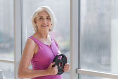 Ambition Smiling Woman Exercising Near The Window. Stock Photography